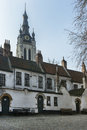 Kortrijk beguinage and the tower of st martin s maarten churc church belgium Stock Photos