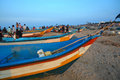 Kovalam beach with fishing boats and nets in chennai india Stock Photo