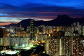 Kowloon cityscape in Kong Kong with lion rock mountain Royalty Free Stock Photo