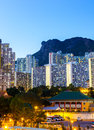 Kowloon side in hong kong at night with lion rock mountain Stock Image