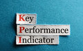 Kpi abbreviation key performance indicator on blue paper Royalty Free Stock Images
