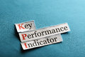 Kpi abbreviation key performance indicator on blue paper Stock Photo