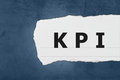 Kpi or key performance indicator with white paper tears on blue texture Stock Photos