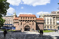 Krakow barbican fortress poland may people at on may in poland it is a historic gateway leading into the old town of Royalty Free Stock Photography