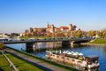 Krakow panorama with zamek wawel castle and vistula river of cracow poland zaemk podwawelski bridge a restaurant on the barge in Stock Images