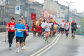 Krakow poland april cracovia marathon spartans children charity group speed on the city streets in Stock Photos