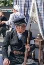 Krakow, Poland - September 23, 2018: ninjured Man dressed in Polish uniforms costume from World War I, holding a shotgun