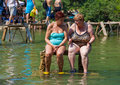 Kravice waterfalls bosnia and herzegovina aug elderly women relaxing in a river on august at in bh it is Royalty Free Stock Photography