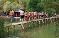 Kravice waterfalls bosnia and herzegovina aug tourists crossing a bridge on august at in bh it is frequently Royalty Free Stock Photography