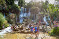Kravice waterfalls bosnia and herzegovina aug tourists standing in a waterfall on august at in bh it is Royalty Free Stock Photography