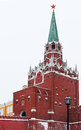 Kremlin Troitskaya Tower in winter snowing day Stock Photos