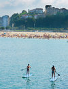 Ksup paddle surf in the beach sup with boats background Royalty Free Stock Photography