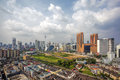 Kuala lumpur cityscape malaysia central with old neighborhood houses against cloudy blue sky Royalty Free Stock Photo