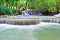 Kuang si falls sometimes spelled kuang xi three tier waterfall kilometres mi south luang prabang laos Royalty Free Stock Photography