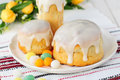 Kulitch kulich russian easter bread topped with sugar icing decorated with eggs candies copy space for your text Stock Photos