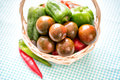 Kumato brown tomatoes in basket closeup Stock Image
