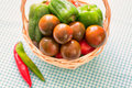 Kumato brown tomatoes in basket closeup Royalty Free Stock Image