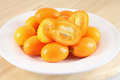 Kumquat pygmy orange sweet citrus fruits Stock Photos