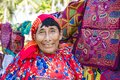 Kuna woman, Panama with traditional art works  - Molas, Royalty Free Stock Photo