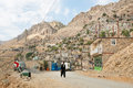 Kurdish man walk on rural road from the old mountaine village in Middle East. Royalty Free Stock Photo