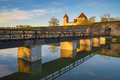 Kuressaare castle with bridge over the moat in beautiful sunrise Royalty Free Stock Photo