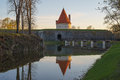 Kuressaare castle tower with bridge over the moat in sunset ligh Royalty Free Stock Photo