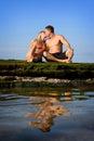 Kuss am Strand Stockbild