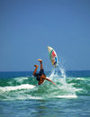 Kuta beach surfing action Stock Photography
