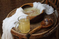 Kvass kvas on house on grain ferment in a transparent mug a wooden table Royalty Free Stock Photo