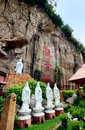 Kwan yin tong in ipoh perak december of goddess of mercy cave temple is located at gunung rapat there are about statues of Royalty Free Stock Images