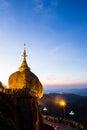 Kyaiktiyo pagoda in the morning golden rock pagod mt myanmar january several burmese men of buddhist faith apply gold leaf or pray Royalty Free Stock Photos