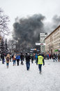 Kyiv protesters during clashes with police black smoke rises from the burning wheels Stock Image