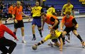 Kyiv ukraine april netherlands handball players in orange defend their net during ehf euro qualification game against ukraine on Royalty Free Stock Photos