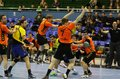 Kyiv ukraine april ukrainian handball players in yellow play a match against netherlands in qualification for handball ehf euro on Stock Photo