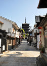 KYOTO, JAPAN - OCT 21 2012: Tourists walk on a street leading to Stock Photos
