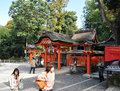 KYOTO, JAPAN - OCT 23 2012: A tourist at Fushimi Inari Shrine Stock Photography
