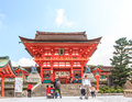 KYOTO, JAPAN - OCT 30 : Tourists at Fushimi Inari Shrine on October 30 2013. The shrine is famous for its torii gates walkway Royalty Free Stock Photo