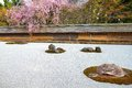 Kyoto japan zen stone garden at famous ryoanji ryoan ji temple buddhist zen temple of rinzai school Royalty Free Stock Photography
