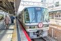 KYOTO - OCT30, 2013: Travelers train at Kyoto railway station  i Royalty Free Stock Photo