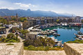 Kyrenia north cyprus boats and houses and reflections marina of in northern Stock Photo