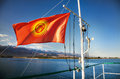Kyrgyzstan flag national with shanirak and sun on the yacht on issyk kul lake Royalty Free Stock Image