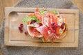 Läckra parma ham sandwich on wooden plate Arkivfoto