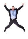 L homme d affaires sautant dans la joie Photographie stock libre de droits