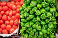 La boqueria market barcelona green chili peppers and ripe red tomatos on sale at the food spain Royalty Free Stock Image