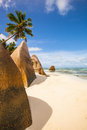 La digue beach rocks and palm at the of seychelles Stock Photos
