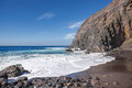 La gomera playa del trigo lonely beach with black sand and impressive rock backdrop at the near alojera in the west of canary Royalty Free Stock Image