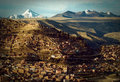 La paz houses in a town with a mountain range in the background macrodistrito maximiliano paredes bolivia Stock Photos