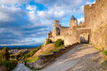 La porte de aude and street at late afternoon in with great sky carcassonne france Stock Image