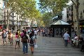 La rambla barcelona the street is bustling with crowds of tourists and locals the high street is famous for shopping eating and Stock Photography
