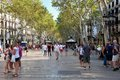 La rambla barcelona the street is bustling with crowds of tourists and locals the high street is famous for shopping eating and Royalty Free Stock Photo